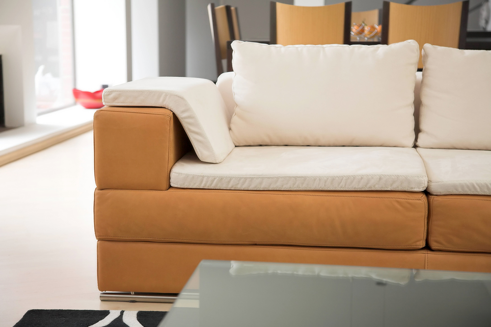 A second hand sofa in a living room space, to represent thoughts around consumer insight research